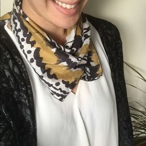 Silk-like scarf with fun black and gold pattern